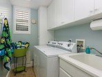 Full size washer and dryer.  Laundry soap and fabric softener are provided
