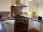 La Chataigne's well equipped kitchen with range cooker