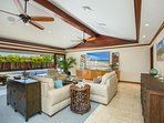 Enjoy the superior living room sound system with an 85-inch ultra-high-definition television, air conditioning...