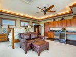 The master suite comes with a built-in wet bar, mini fridge, wine fridge, washer and dryer, and lanai with peek-a-boo...
