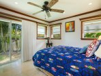 The surf bedroom has yoga lawn views, a sliding door that leads to the pool area, and a cherry wood closet system with...