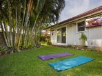 Outside the first-floor master bedroom, facing the queen bedroom with surf bedding, take a meditation break on the...