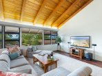 Large open concept living room with views of the ocean!