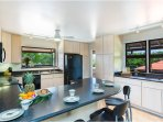 Kitchen, centrally located to the out patio and dining room!