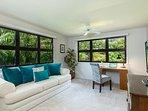 Bonus living room with gorgeous garden views.