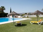 Loungers and parasols free for your use round the pool