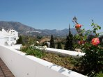 Views from outside property to mountains and the white washed village of Mijas Pueblo