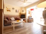 Spacious lounge with sofa bed, dining area, wifi, air con, patio doors to terrace, ceiling fan