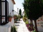 Spanish walkways with flowers and shrubs