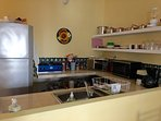 fully equipped kitchen, including a counter-top gas stove.