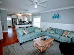 Relax on the plush couches in the living area during your downtime.