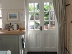 double doors leading from the kitchen onto the sunny patio
