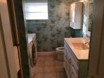 guest bathroom, washer/dryer, full tub and shower