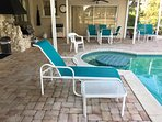 plenty of poolside seating including built-in table and seats in the pool