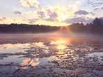An amazing spring sunset view of the ice breaking up on Woods Pond. Beautiful views year-round.