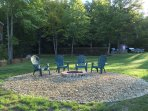 """View of the completed recessed """"fire brick"""" bonfire pit just 8' ft from the water's edge."""