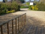 Enterance drive and parking right by back door with decking platform across garden