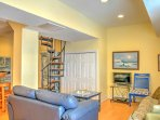 Cozy up on one of the couches in the living area while watching your favorite shows on the flat-screen TV.