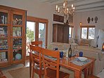 Taos Eagle Nest living / dining view to patio