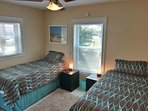 2nd bedroom features 2 XL twin beds with pillow top mattresses. Combine them for another king bed.