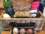 A welcome hamper on arrival with locally sourced produce including apple juice, biscuits, jam etc.