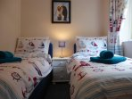 A lovely Nautical Twin Bedroom with View of the rear Cottage Garden