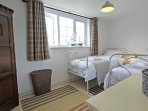 The twin bedroom has full size single beds