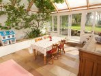 Sunroom dining, with doors to garden