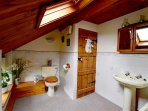 This spacious family bathroom is situated on the first floor