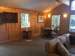 Family game room with bumper pool, electric darts and game table