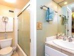 En suite bathroom with step in shower & tub.
