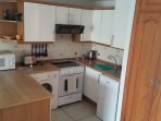 Kitchen with cooker, fridge, microwave, toaster, kettle etc.