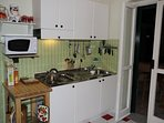 Well equipped kitchen area.  Leading to balcony.  All you need to cook your perfect pasta.