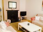Cosy and comfortable living room with open fire and stunning views of the Comeragh Mountains.