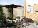 Sun trap garden with table and chairs
