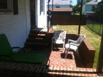 Patio showing large fenced back yard, good for kids and pets