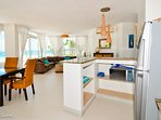 Open kitchen with view to dining, living areas