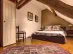 Pottery Barn style third bedroom with a beautiful Queen size bed & lovely view