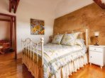 Lovely second bedroom with a gorgeous wrought iron Queen bed & ensuite bathroom