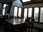 Dining area w/ skylights. Entry level.