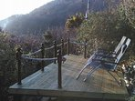 Hillside decking overlooking estuary