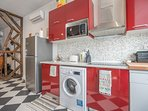 fully equipped kitchen with microwave oven, Nespresso coffee machine, toaster, kettle, dishwasher