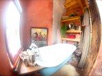 Clawfoot tub tucked away