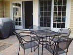 Stone patio off enclosed porch