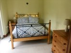 Bedroom one - double bed, side table/stool, chest of drawers, wardrobe.