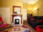Cosy sitting room with woodburning stove effect fire.