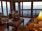 Comfortable living room with lake and mountain views