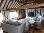Hayloft lounge with TV and DVD player