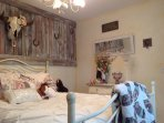 charming cowgirl-themed bedroom with queen bed