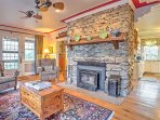 The main floor of the original residence includes a wood stove insert in the living area, a dining room, country...